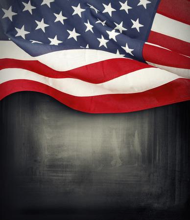 patriotic background: Closeup of American flag on dark background