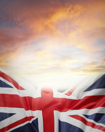 Union Jack flag in front of bright sky photo