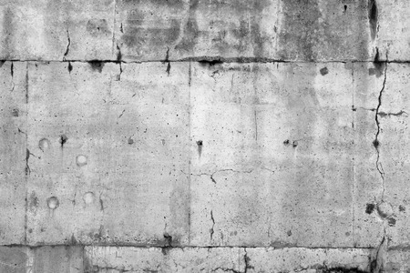 Cracks in grey concrete wall Stock Photo