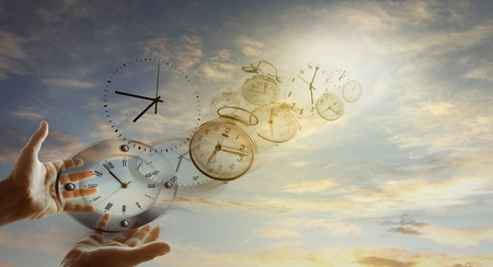 Hands and clocks in sky