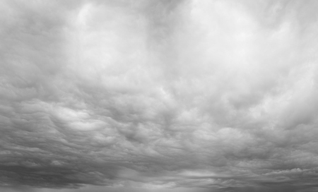Dark ominous grey storm clouds. Dramatic sky photo