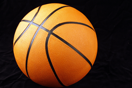 objects equipment: One basketball on black background Stock Photo