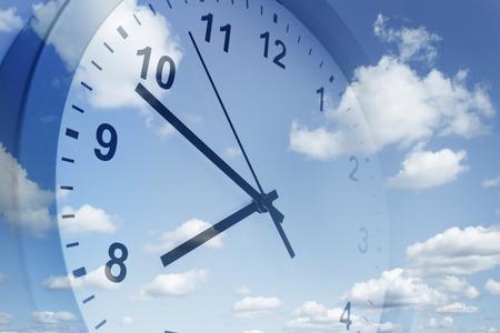 Clock face in blue sky