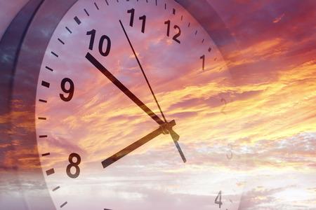Clock face in bright sky 写真素材
