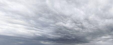 ominous: Dark ominous grey storm clouds