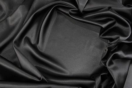 linen fabric: Closeup of rippled black silk fabric