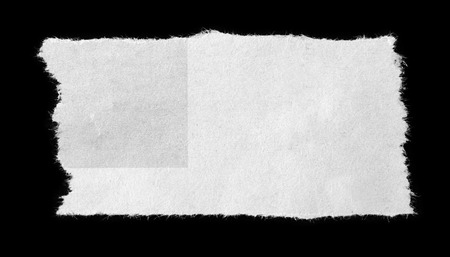 paper note: Piece of torn paper on black Stock Photo