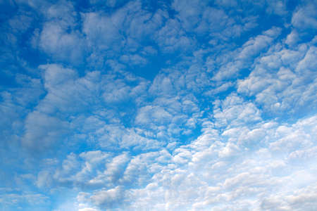 Fluffy clouds in a blue sky photo