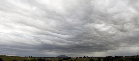 Dark ominous grey storm clouds photo
