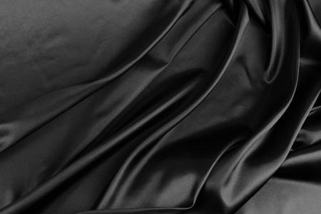 luxurious background: Closeup of rippled black silk fabric