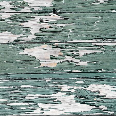 flaking: Closeup of green flaking paint texture
