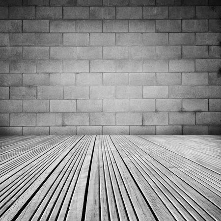floorboards: Wooden floorboards and block wall