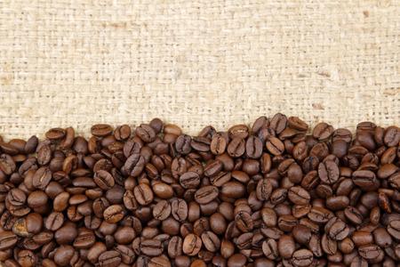 heaped: Closeup of coffee beans on sacking Stock Photo