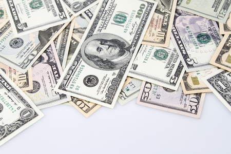 us currency: Closeup of assorted American banknotes on plain background