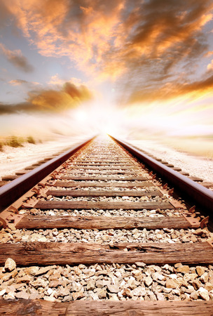 railroad track: Railway tracks vanishing into the distance