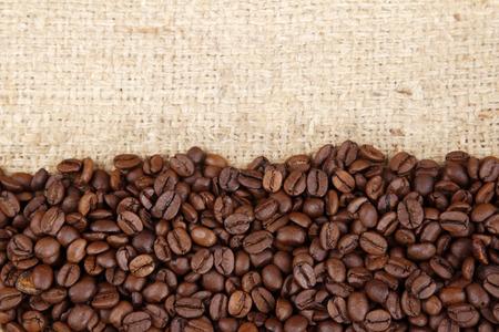 Closeup of coffee beans on sacking Foto de archivo