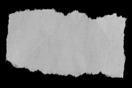 torn paper: Piece of torn paper on black Stock Photo