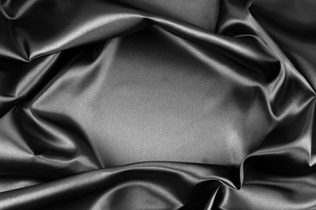 black silk: Closeup of rippled black silk fabric