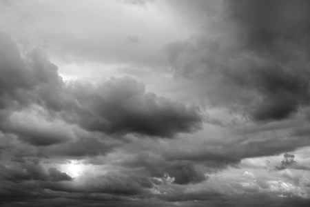 Dark ominous grey storm clouds. Dramatic sky Stock Photo