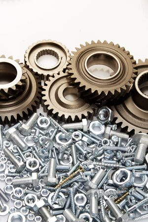 gearing: Metal gears, nuts and bolts Stock Photo