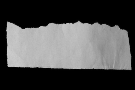 teared: Piece of torn paper on black Stock Photo