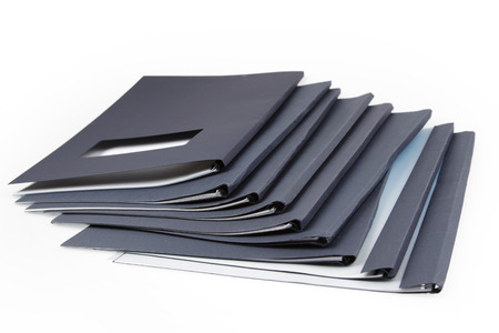 documents: Pile of folders on plain background Stock Photo