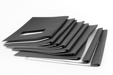 work book: Pile of folders on plain background Stock Photo