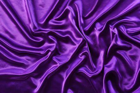 purple silk: Closeup of rippled purple silk fabric