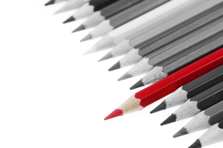 'odd one out': One red pencil standing out from others Stock Photo