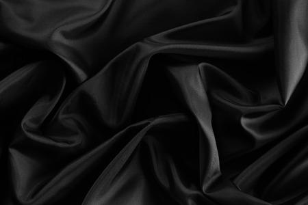 Close-up van golfde zwarte zijde stof Stockfoto - 43668299