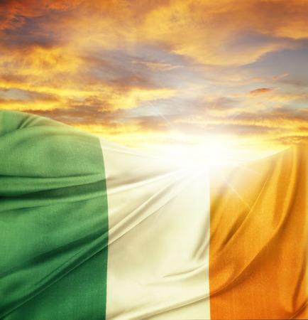 Irish flag in front of bright sky