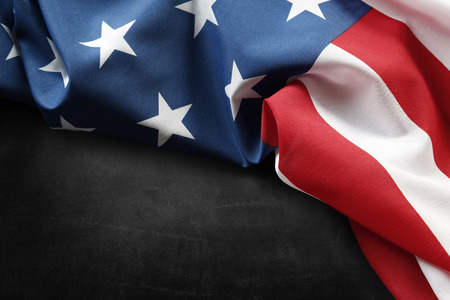 Closeup of American flag on grey background