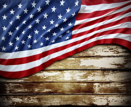 advertise with us: Closeup of American flag on wood