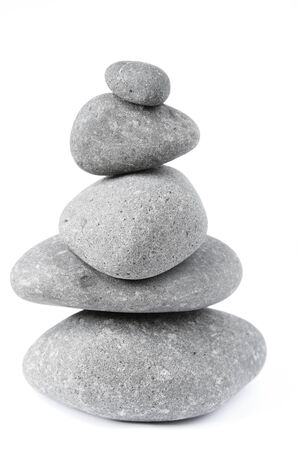 in the rock: Pile of five balanced rocks on plain background