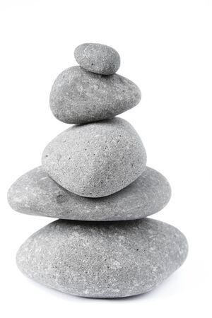 balanced rocks: Pile of five balanced rocks on plain background