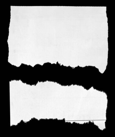 two pieces: Two pieces of torn paper on black