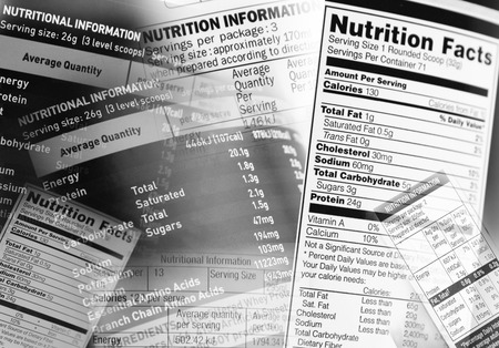 nutrition: Nutrition information facts on assorted food labels Stock Photo