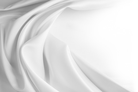 Closeup of rippled white silk fabric Foto de archivo