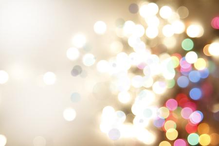 natale: Cerchi colorati di luce sfondo astratto