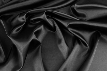 black backgrounds: Closeup of rippled black silk fabric