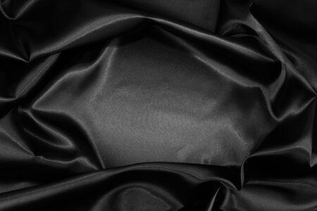 satiny: Closeup of rippled black silk fabric