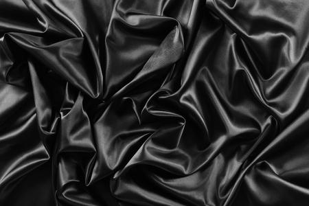 rippled: Closeup of rippled black silk fabric