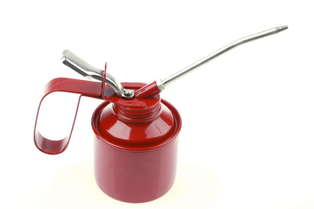 lubricate: Red oil can on plain background