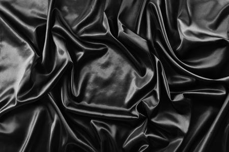 black fabric: Closeup of rippled black silk fabric