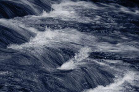 rushing water: Fast flowing mountain stream