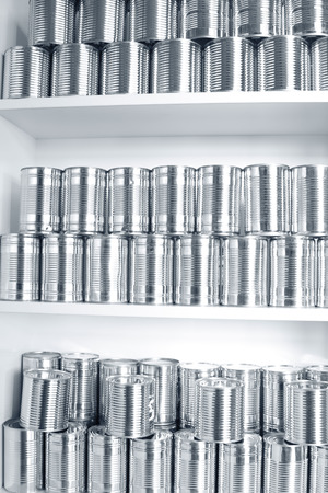 food storage: Tin cans stacked on shelves Stock Photo