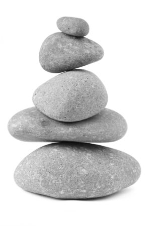 five objects: Pile of five balanced rocks on plain background