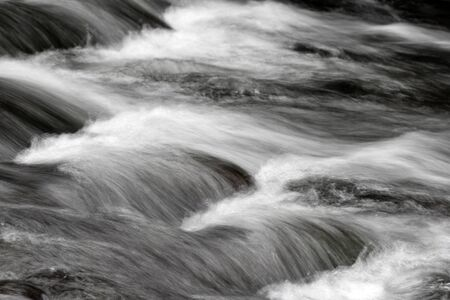 flowing: Fast flowing mountain stream
