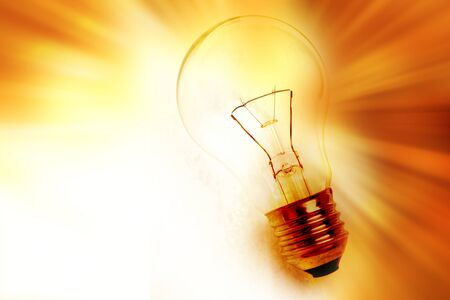 bright light: Light bulb on bright background
