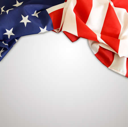 advertise with us: American flag on plain background Stock Photo